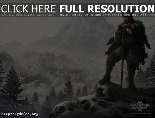 Обои Викинг с топором в заснеженных горах фото картики заставки