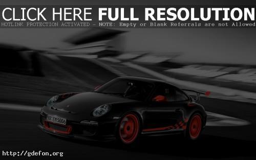 Обои Черный Porsche 911 с яркими оранжевыми дисками фото картики заставки